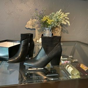 Black pointed and heeled boots